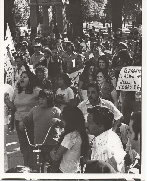 black and white photo of police brutality protest in 1977