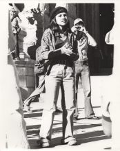 black and white photo of brown beret woman at police brutality protest